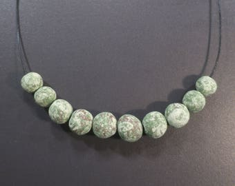 Necklace with green beads