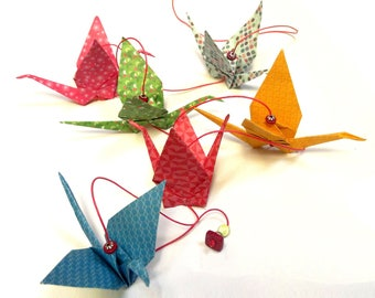 Strings of colorful home decor origami cranes