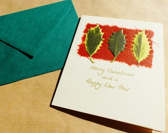 Merry CHRISTMAS and happy New YEAR greeting card with matching envelope Holly leaves
