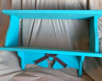 Teal blue wall shelf