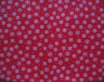 Coupon fabric 100% cotton red snowflakes white