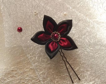 a satin Burgundy and black hair stick