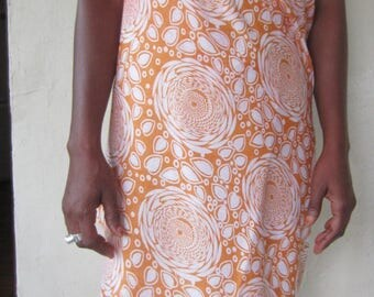Sarong or beach in orange and white dress
