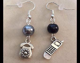 "Mismatched earrings connected ""old phone and laptop"""