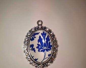 Blue flower cabochon on a white Model 7 pendant