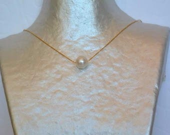 Necklace on gold chain White Pearl