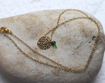 Necklace with gold charm and Green Pearl
