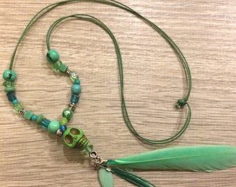 Necklace green skull and feathers