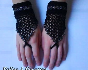pair of mittens in black cotton and blue gold shiny crochet or festive evening ceremony