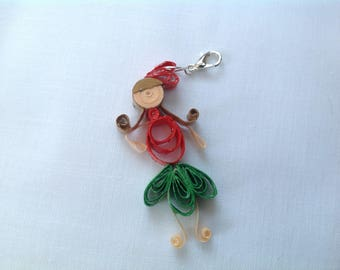 Here is a colorful fairy, quilling charm.