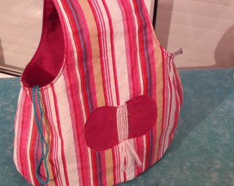 All waterproof hanging tote bag, balls of yarn on the arm, pink and white striped coated cotton