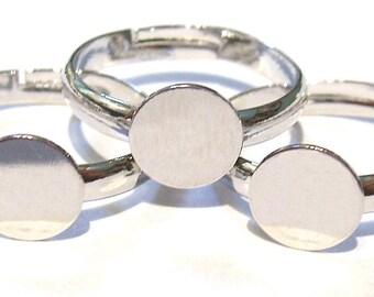3 supports bagues ajustables argentés avec de plateaux de 10 mm.
