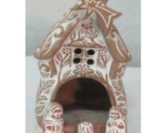 Beautiful gingerbread house Christmas crib