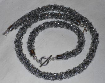 Necklace and Bracelet of gray metallic beads. Handmade. Jewelry for women.