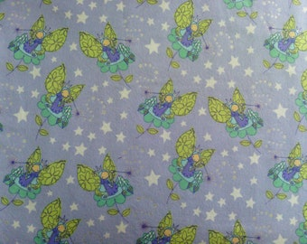 Fabric flannel 96 cm-100% cotton fairies with wings-yellow lilac background
