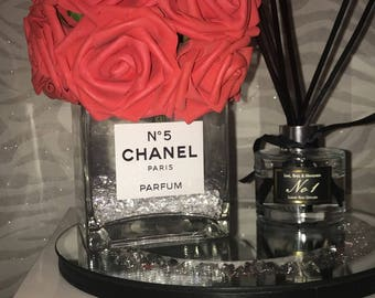 Chanel Vase With Red Roses