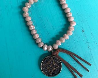 Beaded Bracelet with Repurposed LV pennant and Tassel