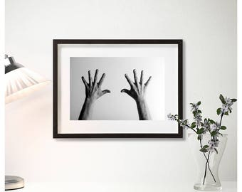 Framed photos, men's hands, furniture photos, black and white photography