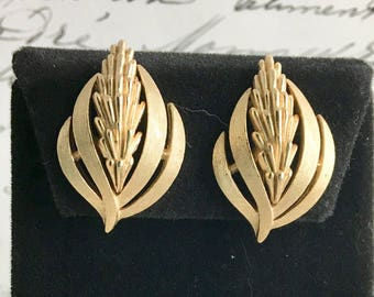 "Vintage Trifari Clip On Earrings, signed, leaf motif, gold tone, 1 1/4"" x 3/4"", 1960's"