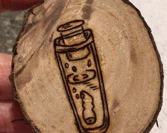 Wood burned magnet slab test tube with finger