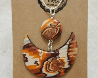 Polymer clay, brown/orange marbled effect pendant necklace.