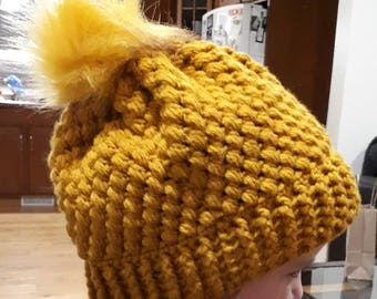 Beautiful hand crocheted hat with faux fur pom pom