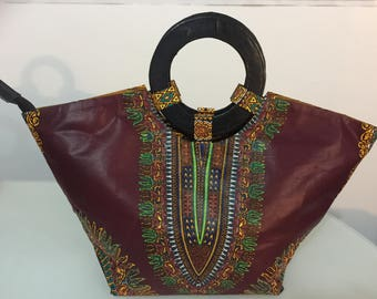 Bag in wax and leather handle