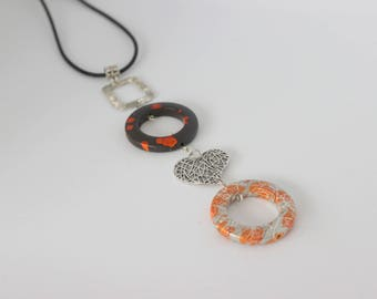 Original vertical necklace in metal and acrylic orange, black and gray.