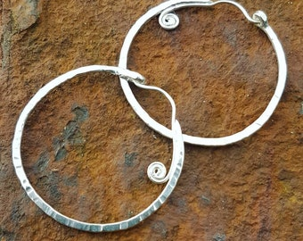 Textured hoop earrings with swirls