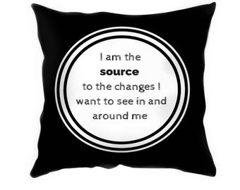 Black and white suede cushion with inspiring quote (Source)