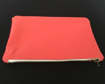Coral leather clutch
