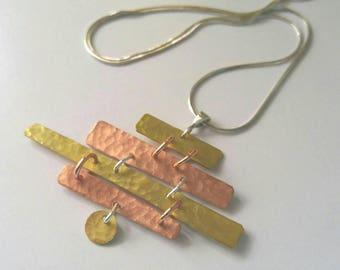 Mel, sterling, copper, brass asymmetric necklace