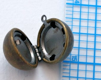 Locket. Vintage brass and steel. Ball, round locket.