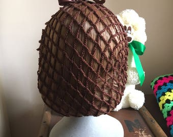 Chocolate brown snood/hairnet crocheted to an original 1940s design.