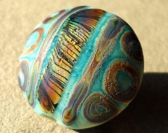 Handmade lampwork glass bead- rustic  lentil bead -Sky Bleached Batiks- Zebra Rainbow Loops and Lines-  in  sky blue and rainbow raku