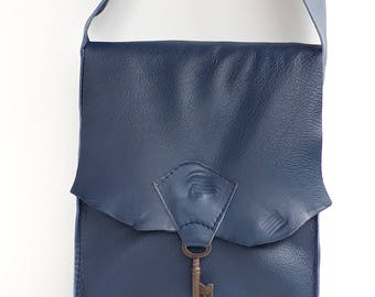 Small raw edge leather bag with vintage key detail - navy blue