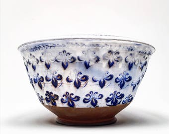 Stamped bowl with blue stain