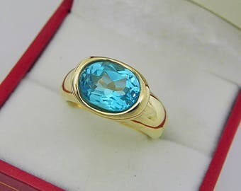 AAAA Swiss Blue Topaz  3.65 carats  10.1x8.1mm in 14K Yellow gold bezel set ring.  0255