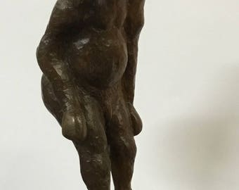 Figure of a Man Carved from Walnut Wood