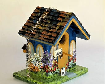Handmade , Unique ,Leaning , Blue and Gold Birdhouse , with Welcome Sign, Lots of Flowers , Little Extras and a Clean Out