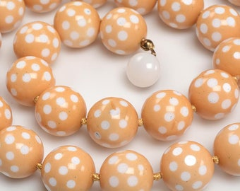 15mm Glass Bead Necklace circa 1940's:  Butterscotch colored cased glass cut to white glass to create polka dots - crisp design, warm color