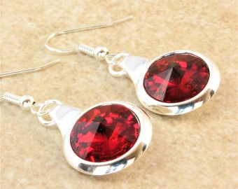 Swarovski Siam Rivoli Crystal in a Silver Plated Round Setting on Silver Plated Ear Wire