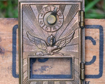 Number 554...   POSTAL box door... T 17