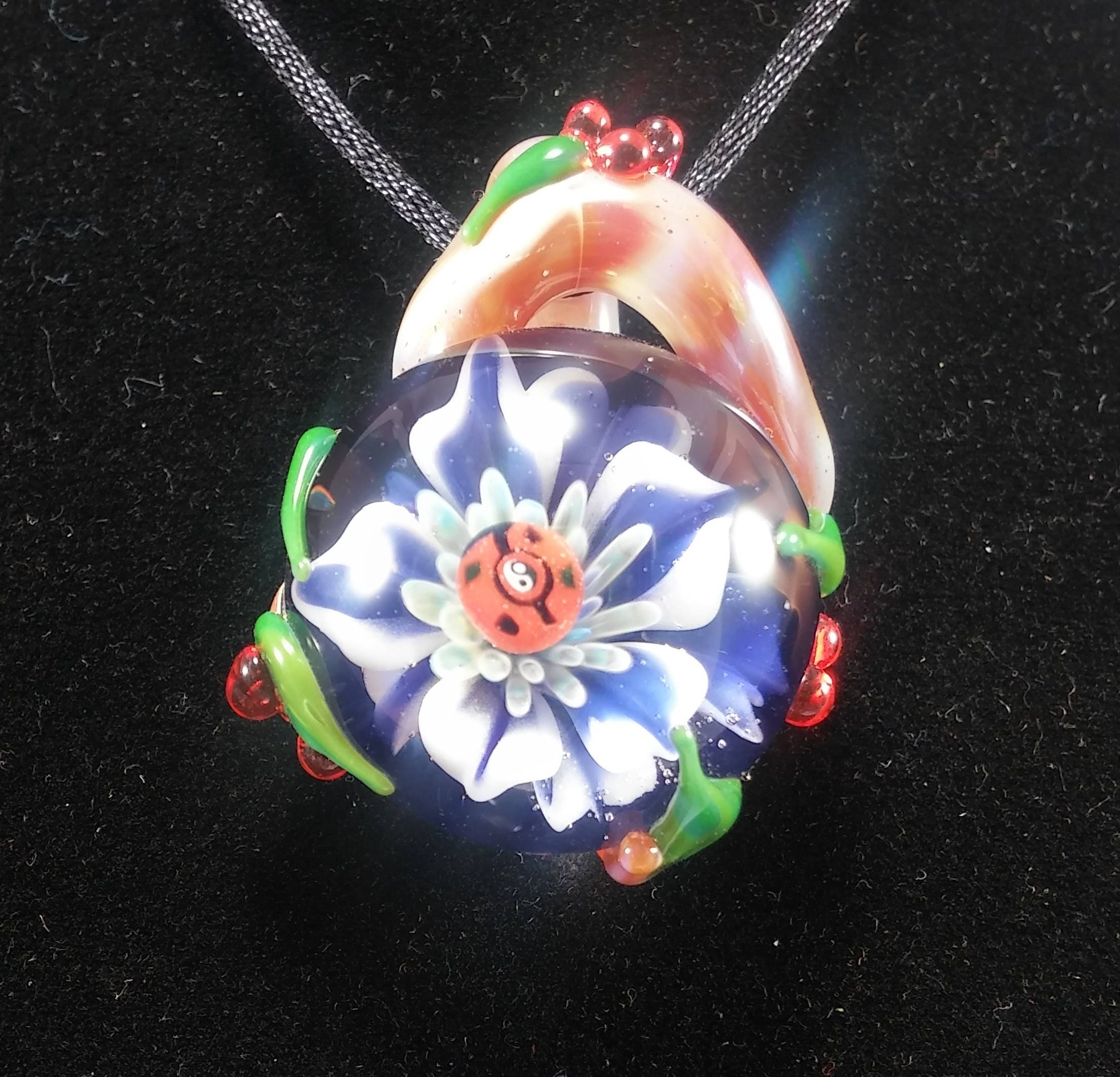 Good luck garden pendant ladybug with a yin yang for its good luck garden pendant ladybug with a yin yang for its center spot blue and white flower with green leaves red berries brown branches izmirmasajfo