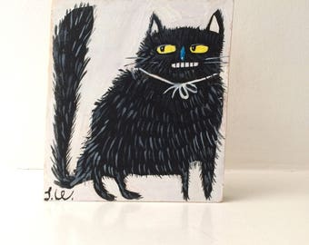Painting on reclaimed wood of a fluffy black cat