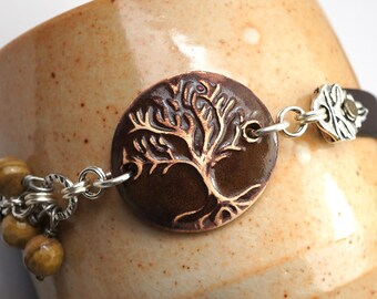 Brown tree bracelet, ceramic leather and silver, earthtones fossilized wood beads, 7 3/4 inches long