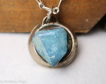 Electroplated quartz set in hand hammered year 2004 US quarter pendant featuring dichroic glass opals on the back side