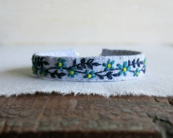 Teal and Blue Floral Fabric Cuff Bracelet - Teal Flowers and A Navy Blue Vine Hand Embroidered on Light Grey Linen Fabric Cuff Bracelet