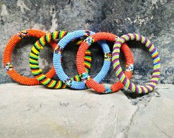 Vintage Jewelry.  Vintage Bangles, 5 Vintage Bangles African/ Native American.  Glass Seed Beads. Handmade Jewelry. Orange. Blue. Green.