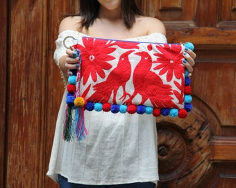 Reds blues  Otomi clutch with pompoms and hand embroidered tassels